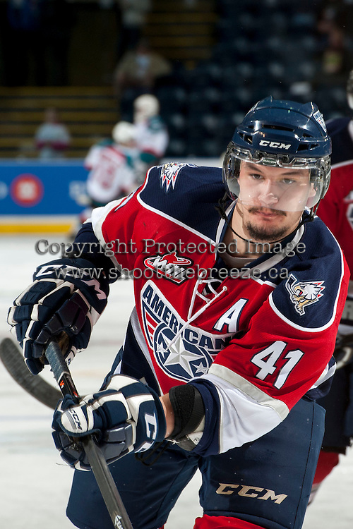 KELOWNA, CANADA - MARCH 28: Jessey Astles #41 of the Tri-City Americans warms up against the Kelowna Rockets on March 28, 2014 at Prospera Place in Kelowna, British Columbia, Canada.   (Photo by Marissa Baecker/Shoot the Breeze)  *** Local Caption *** Jessey Astles;