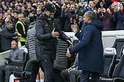 Liverpool manager Jurgen Klopp greets Brighton and Hove Albion manager Chris Hughton during the Premier League match between Brighton and Hove Albion and Liverpool at the American Express Community Stadium, Brighton and Hove, England on 12 January 2019.