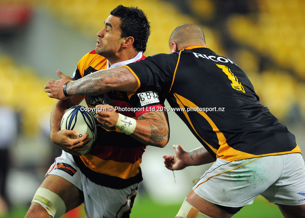 Liam Messam is tackled by Wellington prop John Schwalger. ITM Cup rugby union - Wellington Lions v Waikato at Westpac Stadium, Wellington, New Zealand on Saturday, 21 August 2010. Photo: Dave Lintott/PHOTOSPORT