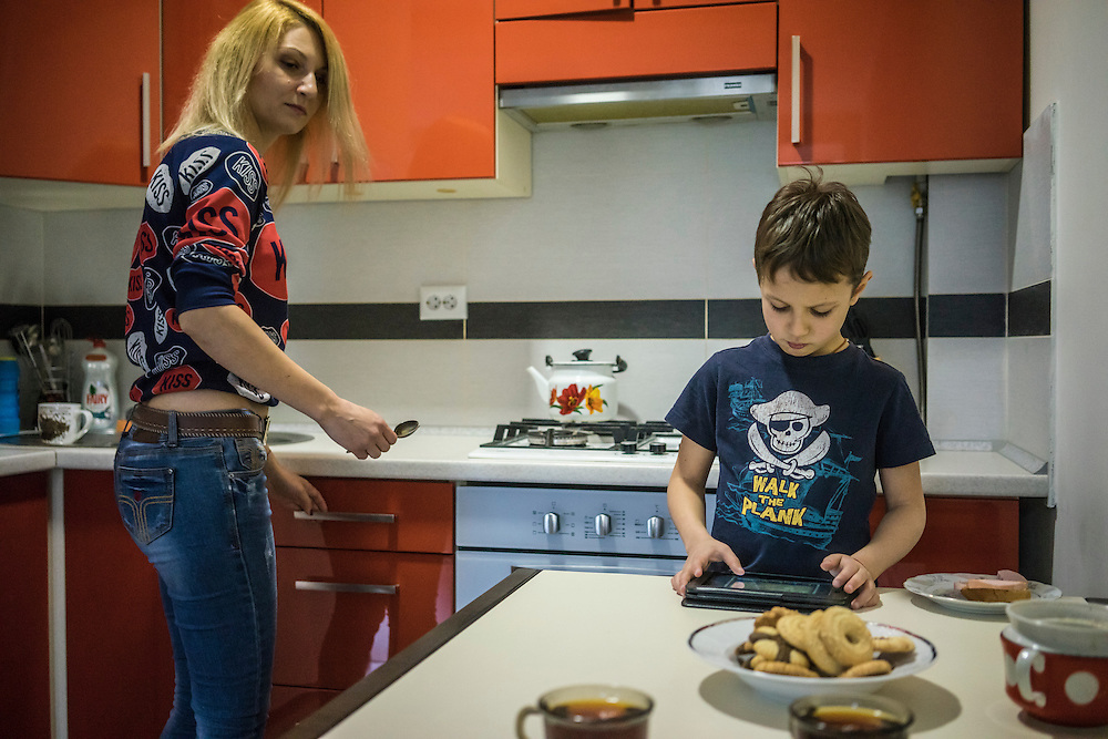 Olga Kirichuk, 29, prepares lunch for her son Yaroslav, 6, on Tuesday, April 28, 2015 in Lviv, Ukraine. After her husband joined forces with pro-Russian rebels in eastern Ukraine, she left him and other members of her family with anti-Ukrainian views and took her son to Lviv, where they live with a friend. CREDIT: Brendan Hoffman/Prime for the Wall Street Journal UKRMIGRATION