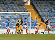 Cambridge United Defender Mark Roberts header on goal leads to Cambridge United Midfielder Luke Berry pulling one back during the Sky Bet League 2 match between Portsmouth and Cambridge United at Fratton Park, Portsmouth, England on 27 February 2016. Photo by Adam Rivers.