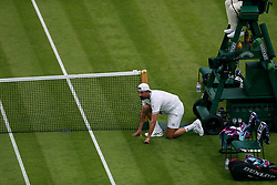 Goran Ivanisevic takes over a ball boy duty on No.1 court at The All England Lawn Tennis Club, London.