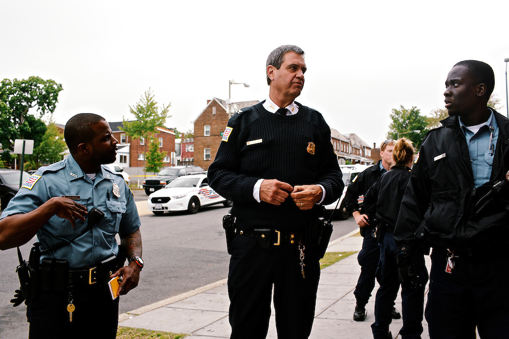 DC police commander Andy Solberg talks with his officers after they arrested a man allegedly trying to rob a liquor store.