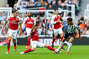 Lucas Torreira (#11) of Arsenal slides in to win the ball from Jacob Murphy (#7) of Newcastle United during the Premier League match between Newcastle United and Arsenal at St. James's Park, Newcastle, England on 15 September 2018.