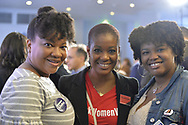 Garden City, New York, USA. November 6, 2018. Nassau County Democrats watch Election Day results at Garden City Hotel, Long Island.  L-R, JACKIE DUODU-BURBRIDGE, of Copiague, RETHA FERNANDEZ, of Babylon, and KIANA BIERRIA, of Freeport, are supporters of Liuba Grechen Shirley, candidate for New York Congressional District 2.