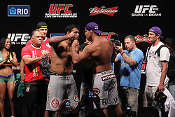 August 26, 2011; Rio De Janiero, Brazil; Brendan Schaub (left) and Minotauro Nogueira (right) pose after weighing in for their upcoming bout at UFC 134.