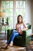 Stacey Love, owner of Stacey Love Construction & Design, poses for a portrait in the sun room a home she worked on for this year's Tour of Remodeled Homes in Prospect.