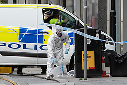 © Licensed to London News Pictures. 11/10/2019. Manchester, UK. Forensic scenes of crime examiners working at the scene . Terrorism Police are investigating after four people were stabbed during a single attack at the Arndale Centre in Manchester City Centre . Photo credit: Joel Goodman/LNP