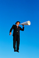 Businessman Speaking with Megaphone --- Image by © Jim Cummins/CORBIS