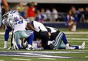 Players watch as medical staff attends to Dallas Cowboys quarterback Tony Romo (9) after suffering a broken clavicle on a wicked hit during<br />  the NFL week 7 football game against the New York Giants on Monday, October 25, 2010 in Arlington, Texas. The Giants won the game 41-35. (©Paul Anthony Spinelli)