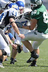 15 September 2007:  Bryan Kelly falls backwards after Joel Steinmetz meets him with a teeth rattling block. The Titans stood toe to toe with the 25th ranked Lions through the first half but ended the game on the losing end of a 25-15 score at Wilder Field on the campus of Illinois Wesleyan University in Bloomington Illinois.