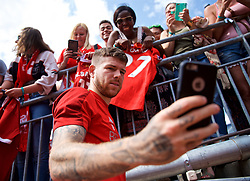 ANN ARBOR, USA - Friday, July 27, 2018: Liverpool's Alberto Moreno takes a selfie with a supporter's iPhone after a training session ahead of the preseason International Champions Cup match between Manchester United FC and Liverpool FC at the Michigan Stadium. (Pic by David Rawcliffe/Propaganda)
