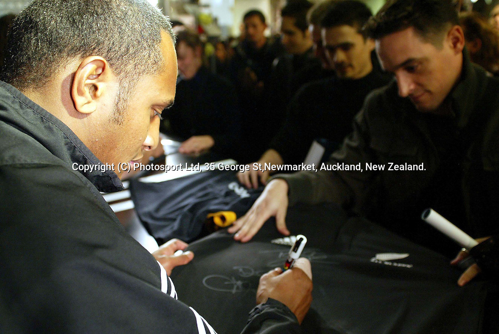 All Black Joe Rokocoko signs autographs at the Adidas store in central Paris this evening. France, 24th November 2004. <br />PHOTO: Paul Thomas/PHOTOSPORT.