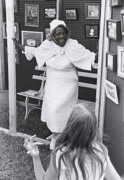 Singer and artist Sister Gertrude Morgan sells her paintings at the second Louisiana Jazz and Heritage festival in Congo Square in New Orleans in 1971.