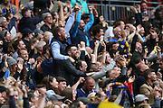 AFC Wimbledon fans celebrate AFC Wimbledon striker Lyle Taylor (33) goal during the Sky Bet League 2 play off final match between AFC Wimbledon and Plymouth Argyle at Wembley Stadium, London, England on 30 May 2016.