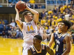 Nov 11, 2016; Morgantown, WV, USA; West Virginia Mountaineers guard Chase Harler (14) drives to the basket during the second half against the Mount St. Mary's Mountaineers at WVU Coliseum. Mandatory Credit: Ben Queen-USA TODAY Sports