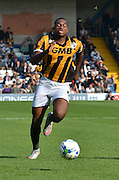 Uche Ikpeazu sprints for the ball during the Sky Bet League 1 match between Bury and Port Vale at Gigg Lane, Bury, England on 19 September 2015. Photo by Mark Pollitt.