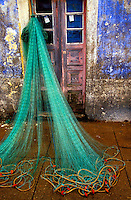 fishing nets drying outside a home in Portugal - Photograph by Owen Franken