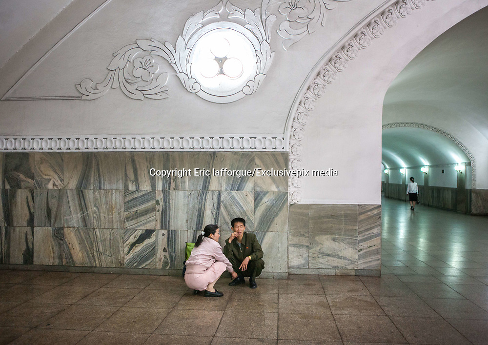 EXCLUSIVE<br /> The Pyongyang subway<br /> The best place to escape american fire and fury<br /> <br />  Built in 1970s, Pyongyang Metro may soon become the best place for north koreans to escape « fire and the fury like the world has never seen » that promises Donal Trump. It includes only 17 stations on two lines, with a total length of 30 km. In Seoul it is about 300 km. Construction of the metro service began in 1968 and was inaugurated in 1973 by Kim Il Sung, the grandfather of Kim Jong Un.  Before entering the platform, one must purchase a ticket and go through the checkpoint. The fare is cheap, only 5 wons, half of a US cent.<br /> You have to validate your ticket at one of these automatic machines. But they did not work the day I visited. Instead, a train attendant checked was checking the tickets by hand.  Like in so many others places, the visits of the Dear Leaders are immortalized by a red billboard telling the date they visited the place.<br /> So you will learn Kim Il Sung used this escalator. You can also find out what he has done in his life, as the North korean propaganda set up a billboard every time<br /> they visited a place.  There are only 2 metro lines, so getting lost is not easy.<br /> Each station is named after the revolution: Comrade, Red Star, Glory, Liberation, Signal Fire, Rehabilitation, Victory, Paradise, Restoration... not named after places though.  Going down the 120 meters takes just few seconds but you feel like being in a movie as the revolutionary music and patriotic songs are played all around from the loudspeakers.<br /> Everybody stays at his/her place, no one tries to jump the queue.  The Pyongyang Metro runs an astonishing 360 feet below street level, making it the deepest metro system in the world.  You will walk through huge and long corridors to access the platforms. The corridors can be closed with massive gates that seal the station from the outside world. It is because they are designed to serve as underground shelt