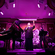 "November 19, 2012 - New York, NY : Singer-songwriter Sandy Stewart performs her routine ""Something to Remember"" at Feinstein's at Loews Regency in Manhattan on Monday evening. She is accompanied by her son, pianist Bill Charlap (left), and bassist Peter Washington (barely visible at right). CREDIT: Karsten Moran for The New York Times"