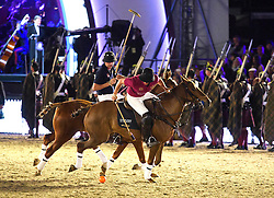 © Licensed to London News Pictures. 15/05/2016. Windsor, UK.  People playing polo in the arena. An evening event held at the Royal Windsor Horse show to celebrate the 90th birthday of HRH Queen Elizabeth II. Acts from arounds the world have been invited to perform at the evening event, set in the grounds of Windsor Castle. Photo credit: Ben Cawthra/LNP