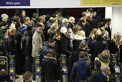 © Licensed to London News Pictures. 09/01/2017. London, UK. Commuters wait for overground trains at Waterloo Station as London Underground services are severely disrupted due to RMT and TSSA unions' 24-hour strike action in a dispute over jobs cuts and closed ticket offices on January 9, 2017. Photo credit: Tolga Akmen/LNP