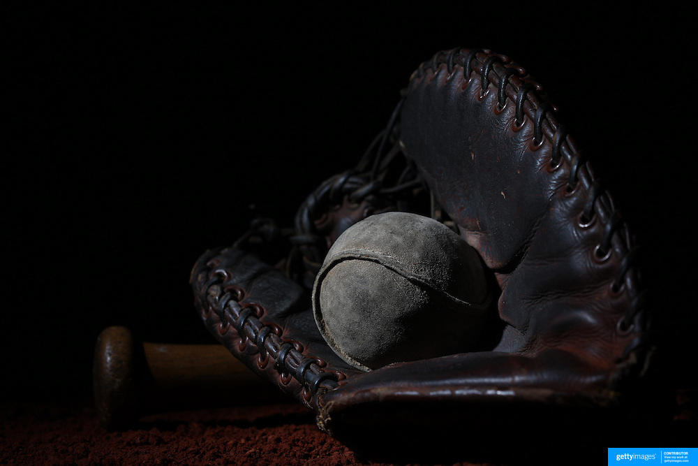 A vintage antique baseball glove, used baseball and baseball bat. 7th June 2012. Photo Tim Clayton