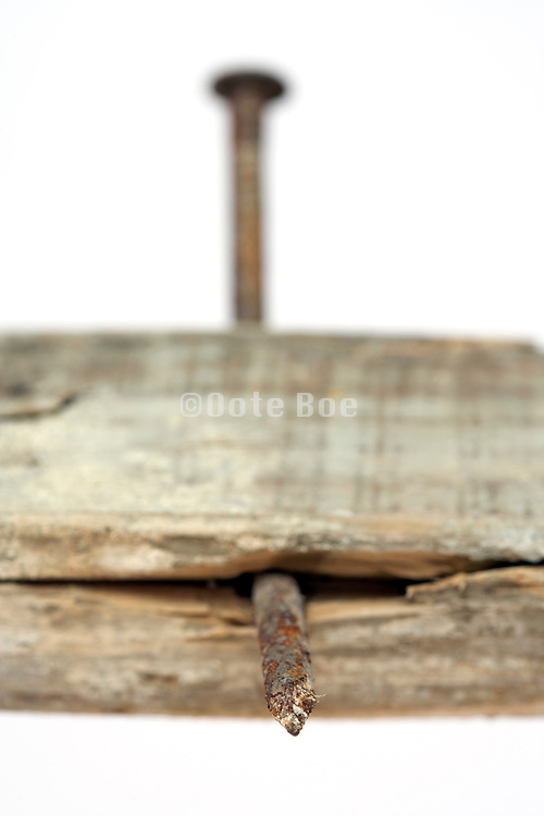 old rusty nail in a wooden beam