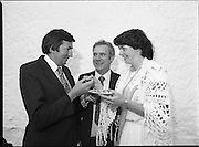 """The Carlingford Oyster Festival.1982.19.08.1982..08.19.1982.19th August 1982..Pictures and Images of the Carlingford Oyster Festival...The Minister For Fisheries and Forestry Mr Brendan Daly officially opened  The Carlingford Oyster Festival. The Chairman of the organising committee was Mr. Joe McKevitt..""""The Oyster Pearl"""" was Ms Deirdre McGrath..The Minister is encouraged to try an oyster himself."""