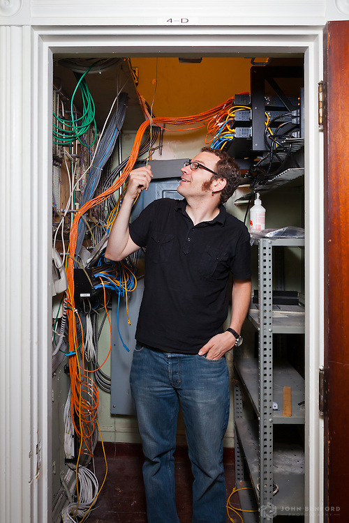 UUA Network Administrator Scott Thomson in one of the tech closets at 25 Beacon Street.