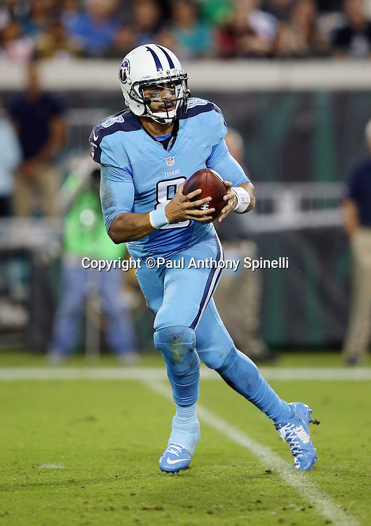 Tennessee Titans quarterback Marcus Mariota (8) drops back to pass during the 2015 week 11 regular season NFL football game against the Jacksonville Jaguars on Thursday, Nov. 19, 2015 in Jacksonville, Fla. The Jaguars won the game 19-13. (©Paul Anthony Spinelli)