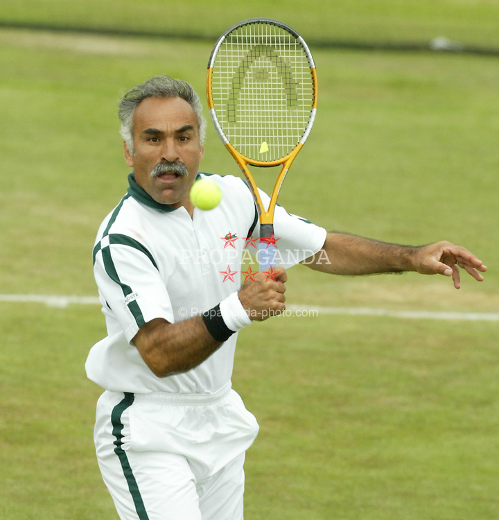 LIVERPOOL, ENGLAND - THURSDAY JUNE 10 2004: Mansour Bahrami in action during the Liverpool International Tennis tournament in Claderstones Park, Liverpool. (Photo by David Rawcliffe/Propaganda)