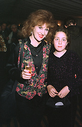 Actress ANITA DOBSON and MISS EMILY MAY daughter of her good friend, musician Brian May, at a party in London on October 21st 1997.MCI 50