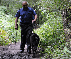 © Licensed to London News Pictures. 08/08/2012 . Police dog search teams searching Birchwoods in New Addington near Croydon for 12 year old Tia Sharp who has been missing since Friday last week. Photo credit : Grant Falvey/LNP