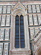 Detail from the façade from the Basilica di Santa Maria del Fiore, more commonly called the 'Duomo'. Florence, Italy. Started in 1296 based on Arnolfo di Cambio's design, but was not complete until 1436 when Filippo Brunelleschi engineered the dome. One of Italy's largest churches. The current façade was designed by Emilio De Fabris in 1871 and was completed in 1887. The original, incomplete façade was dismantled in 1588. The entire façade is dedicated to Christ's mother.