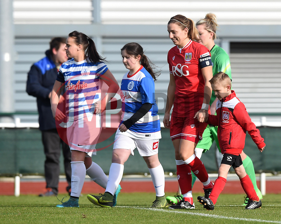 Players and mascots make their way on to the pitch at Stoke Gifford Stadium - Mandatory by-line: Paul Knight/JMP - Mobile: 07966 386802 - 14/02/2016 -  FOOTBALL - Stoke Gifford Stadium - Bristol, England -  Bristol Academy Women v QPR Ladies - FA Cup third round