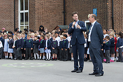 © Licensed to London News Pictures . 03/07/2014 . Leeds , UK . The Deputy Prime Minister , NICK CLEGG MP , at Ireland Wood Primary School in Leeds today (Thursday 3rd July 2014) with Head Teacher , Ian Blackburn (right) . The Liberal Democrat leader and MP for Sheffield Hallam watches a Grand Depart school event with children taking part in cycling time trials and singing the the Tour de France anthem . Photo credit : Joel Goodman/LNP