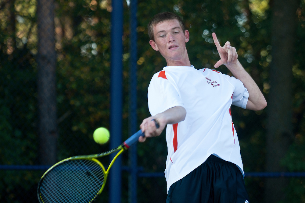 Lathan Goumas | The Bay City Times..Chris Trippett of Flint Powers Catholic High School hits the ball during the 2011 City By the Bay Invitational Tennis Tournament at Garber High School in Essexville, MI., on Saturday September 24, 2011.