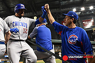 Aug 11, 2017; Phoenix, AZ, USA; Chicago Cubs outfielder Kyle Schwarber (12) is congratulated by catching coach Mike Borzello (58) after hitting a solo home run in the sixth inning against the Arizona Diamondbacks at Chase Field. Mandatory Credit: Jennifer Stewart-USA TODAY Sports