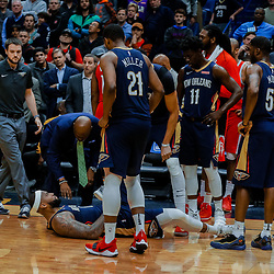 Jan 26, 2018; New Orleans, LA, USA; New Orleans Pelicans center DeMarcus Cousins (0) lays on the ground after sustaining an injury during the fourth quarter against the Houston Rockets at the Smoothie King Center. Pelicans defeated the Rockets 115-113. Mandatory Credit: Derick E. Hingle-USA TODAY Sports