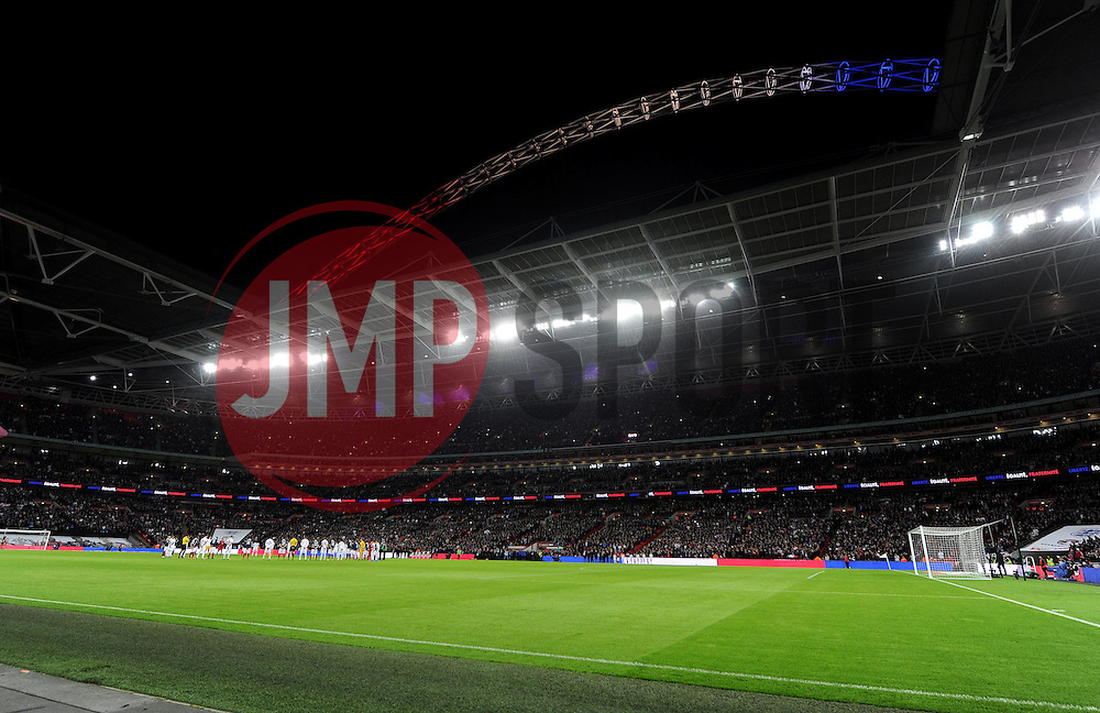 Both teams hold a minutes silence with wembley arch showing in france colours. - Mandatory byline: Alex James/JMP - 07966 386802 - 17/11/2015 - FOOTBALL - Wembley Stadium - London, England - England v France - International Friendly