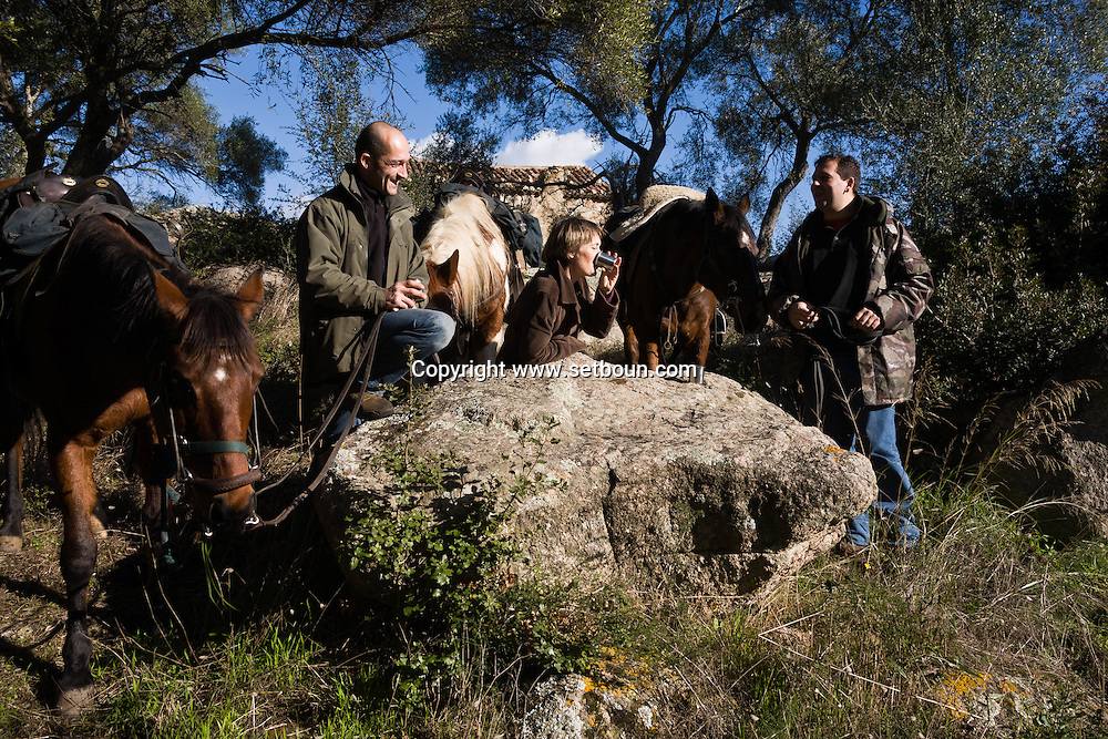 Corsica. France. Horse riding in Mr Preziosi house ,  in Tradicetto  Corsica south  France    / randonnee a cheval arret chez  Mr Preziosi, gite habitat traditionel en pierre  Corse du sud  France  /