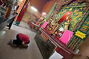 Malaysia, Kuala Lumpur. Chinatown. Offering to the Gods at Guan Di Temple.