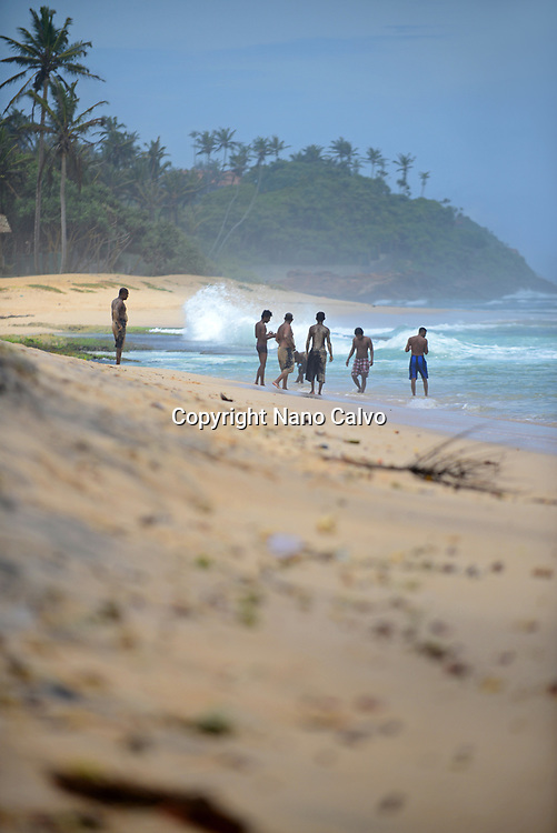 Group of young men having fun on Midigama beach, Sri Lanka