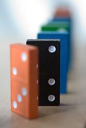 Line of dominoes on the floor at nursery school,