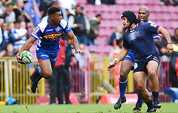 Cape Town-180427 Damian Willemse of Stomers challenged by  Rebels player  Anaru Rangi in a Super 15 match played at Newlands stadium.photograph:Phando Jikelo/African News Agency/ANA