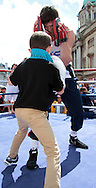 Picture by Richard Gould/Focus Images Ltd +44 7855 403186<br /> 22/06/2013<br /> Luke Campbell spars with a young fan from the crowd during a public workout at Queen Victoria Square, Hull.