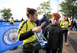 Young Manchester City fan Gruff Jones has his face painted ahead of the match