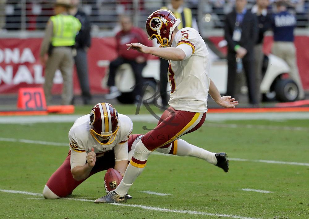 Washington Redskins kicker Dustin Hopkins (3) kicks a field goal as punter Tress Way (5) holds during the first half of an NFL football game against the Arizona Cardinals, Sunday, Dec. 4, 2016, in Glendale, Ariz. (AP Photo/Rick Scuteri)