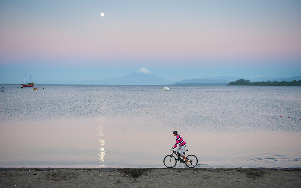Cyclist on Beach, Puerto Varas, Chile